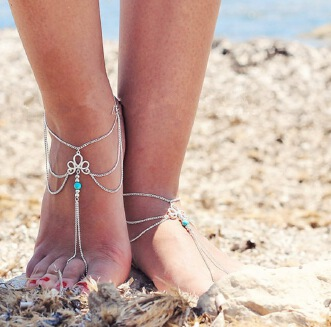 New Europe and the United States adorn article vogue is contracted restore ancient ways hollow out decorative pattern pine stone beaded tassel connects the female of chain of foot that points to the beach